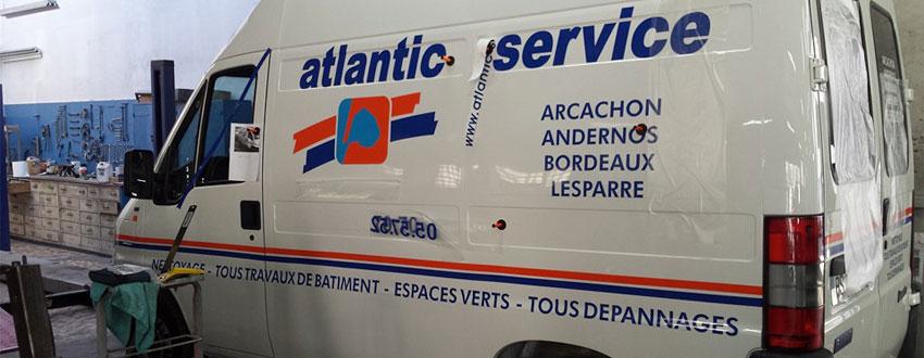 BMJ-publicité Lettrage latéral camion Atlantic services - détail